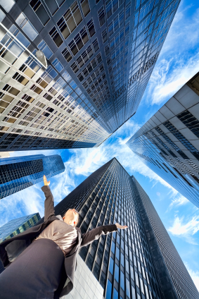 Businesswoman Arms Up in Modern City Office Skyscrapers
